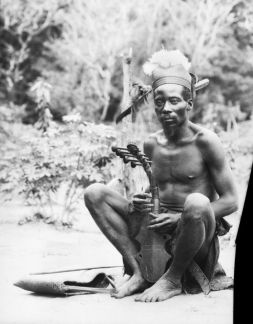 An Azande (D.R.Congo) man playing a harp. Photographed by Herbert Lang in Bafuka's village