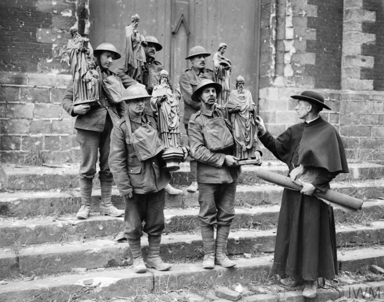 british-soldiers-help-a-french-priest-to-remove-statues-from-a-church-that-has-been-damaged-by-shellfire-armentieres-france-26th-of-february-1918
