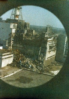27 April, 1986: The first photo to be taken of the reactor, at 4pm, 14 hours after the explosion. This was taken from the first helicopter to fly over the disaster zone to evaluate radiation levels. The film was fogged due to radiation levels of 1500 rems at that altitude.