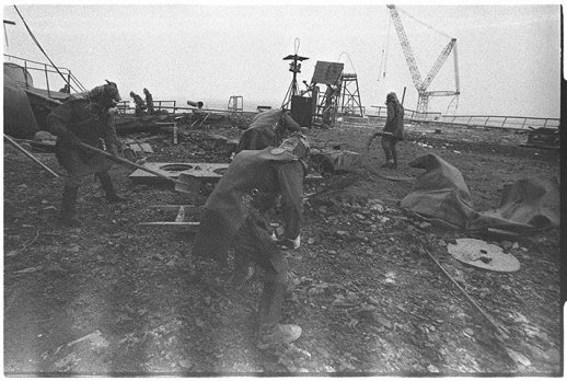 September 1986: 'Liquidators' clean the roof of reactor 3. They could not stay any longer than 40 seconds any one time, before the radiation dose they received reached the maximum a human should receive in an entire life. Many liquidators have since died or suffer from severe health problems Photograph: Igor Kostin