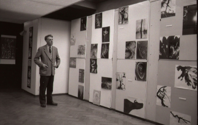 georges-andrien-view-of-the-exhibition-images-inventees-with-julien-coulommier-in-front-of-some-of-his-photographs-1957