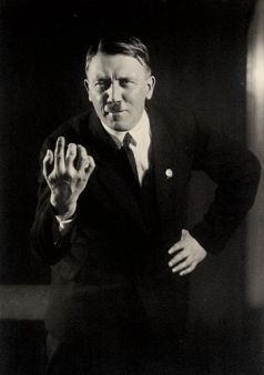 heinrich-hoffmann-posed-portrait-of-adolf-hitler-giving-a-speech-1927
