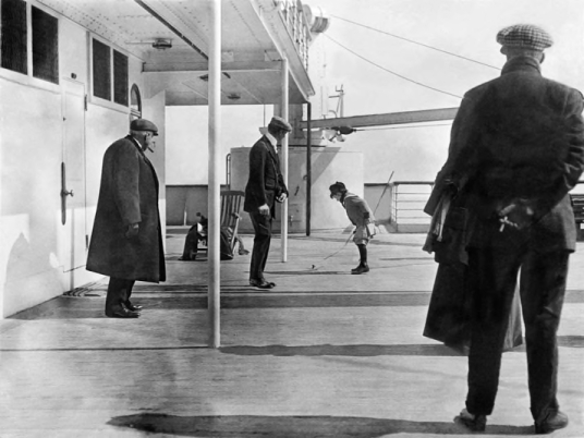 doug-spedden-watched-by-his-father-plays-with-a-spinning-top-aboard-the-titanic-10-april-1912