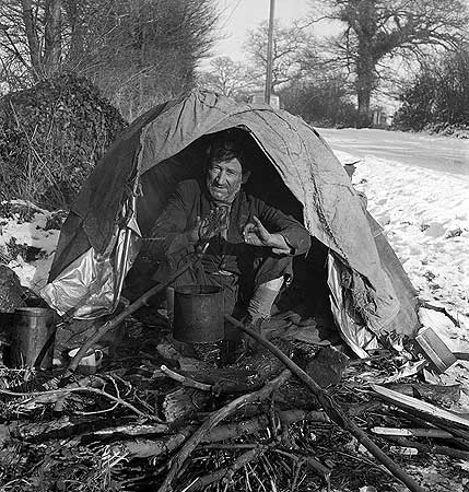 great-missenden-buckinghamshire-move-to-this-image-move-to-this-image-move-to-this-image-great-missenden-buckinghamshire-a-tramp-in-a-makeshift-shelter-warming-his-hands-over-a-camp-fire
