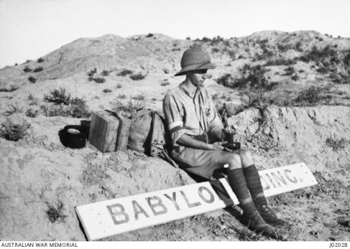 Eric Keast Burke (c.1917) self portrait on road to Babylon, Iraq.