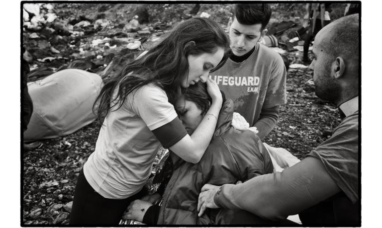 lesbos-greece-a-young-greek-volunteer-from-the-sea-rescue-corps-comforts-an-iraqi-refugee-sunduz-34-years-old-a-kurd-from-iraq-fled-mosul-and-daesh-three-months-ago-with-her-husband-and-their-tw