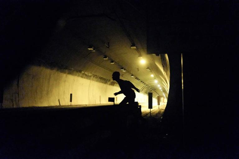 migrants run on night motorway at Italo-French border