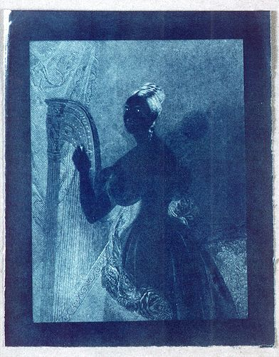 John Herschel An experimental cyanotype of an engraving of a lady with a harp 1842