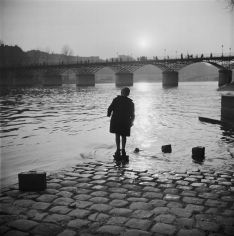 Marcel Bovis (1946) Quai du Louvre: young boy fishing.