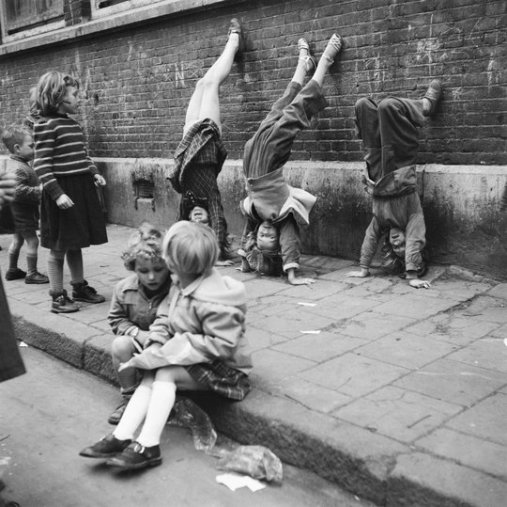 Maria Austria (1953) Girls doing handstands against the wall, Amsterdam.