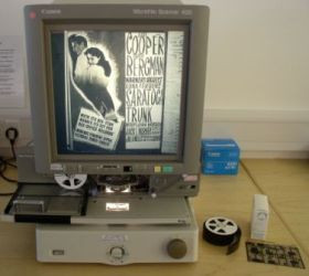 Microfiche viewer capable of displaying microfiche filmstrips or sheets.