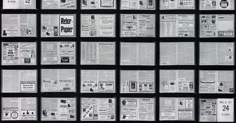 Close-up of a section of a microfiche film. Other versions display white text on a black or blue background.