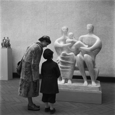 Maria Austria (1950) mother and child before 'Family Group' at an exhibition of Henry Moore, Stedelijk Museum, Amsterdam.