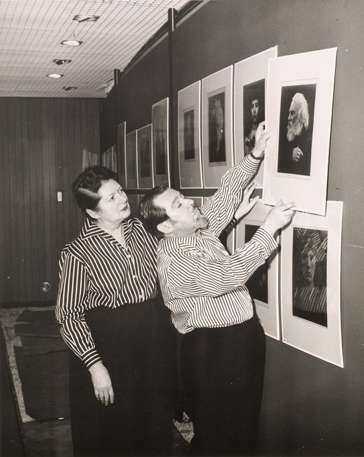 unidentified-photographer-helmut-and-alison-gernsheim-hanging-an-exhibition-at-wayne-state-university-detroit-michigan-1963-gelatin-silver-print