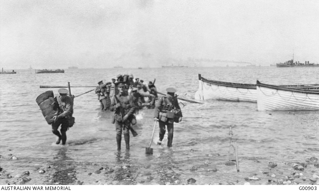Charles Bean landed at Anzac Cove at 9.20 am on 25 April and took this photograph of the 1st Divisional headquarters staff coming ashore. At this time there was fighting on the second ri