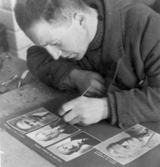 Grossman retouching prints for a photo album in Lodz