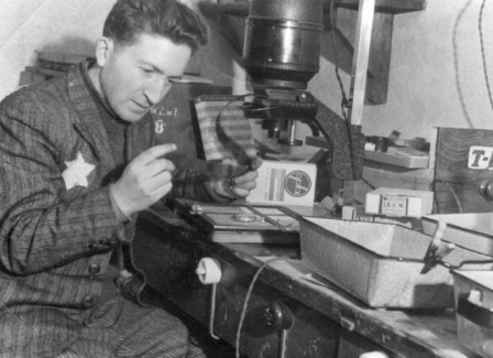 Mendel Grossman at work in his darkroom