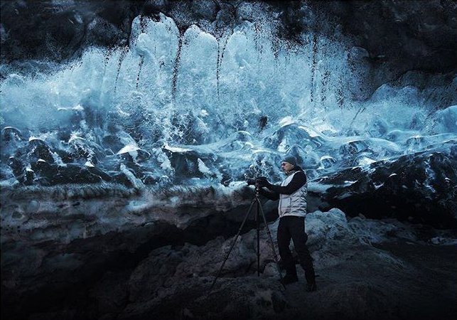 Michael Najjar taking photographs in an ice cave under the glacier in Iceland