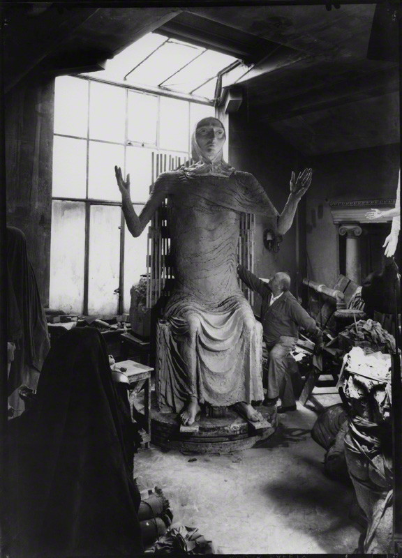 NPG x136748; Sir Jacob Epstein with plaster of 'Social Consciousness' by Ida Kar