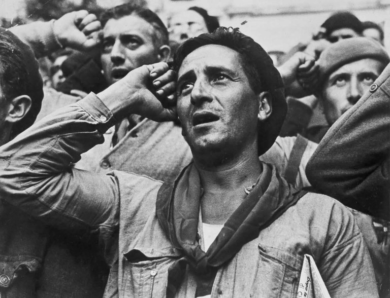 Robert Capa © International Center of Photography Bidding farewell to the International Brigades, which were dismissed by the Republican government, as a consequence of Stalin's friendship with Germany. Montblanc, near Barcelona, Spain. October 25th, 1938.