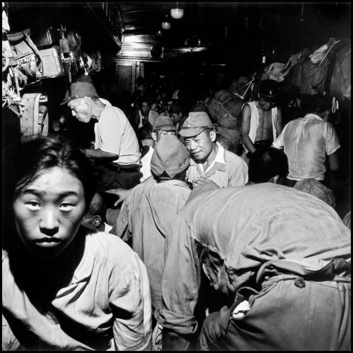Wayne Miller Japanese soldiers and civilians crowd trains bound for Tokyo. Hiroshima, Japan. September 8, 1945