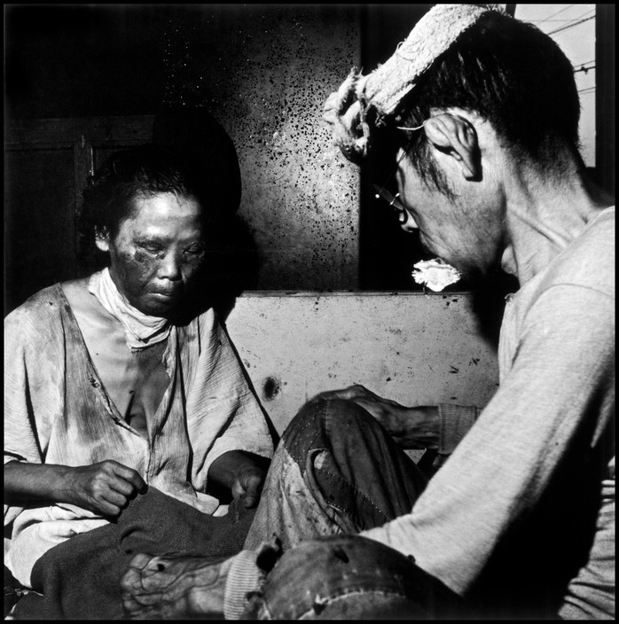 Wayne Miller Victims find refuge in a makeshift hospital in the bank building of Kango Ginku. Hiroshima, Japan. September 8, 1945