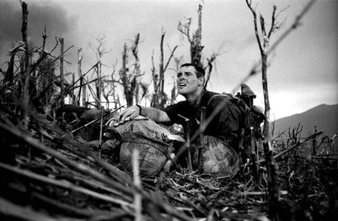 Corpsman Vernon Wike, 2:3rd Marine, looks in anguish when he realizes that his buddy is dead. Battle for Hill 881. 1967