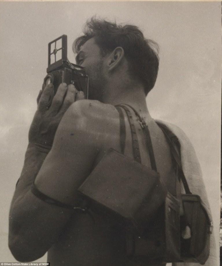 Max Dupain with his cameras by Olive Cotton from Camping trips on Culburra Beach by Max Dupain and Olive Cotton 1937