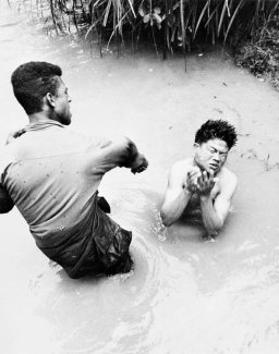 Catherine Leroy (c.1967) Soldiers from the First Cavalry captured Vietcong fighters hiding in a stream in Bong Son, Vietnam.