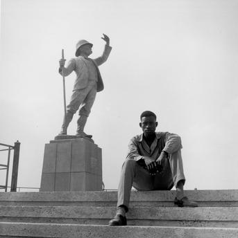 Paul Almasy (1957) Young man at the H.M.Stanley Monument in Kinshasa