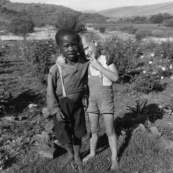 Paul Almasy (n.d.) Farm boys embracing.