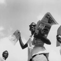 Paul Almasy (c.1966) Newspaper seller in Nigeria