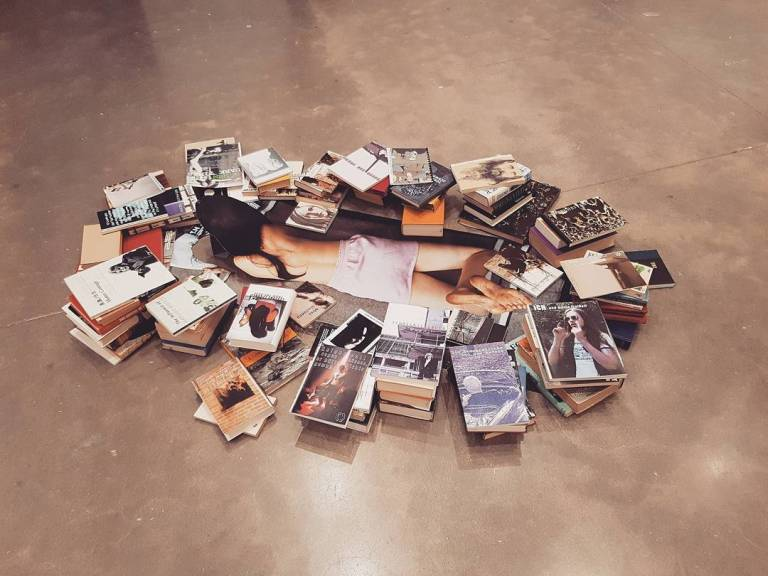 Rosemarie Trockel, Living Means Not Good Enough, 2002. Chromogenic color print, books, and a magazine, approximately 76 3:4 x 46 2:3 x 7 7:8 inches