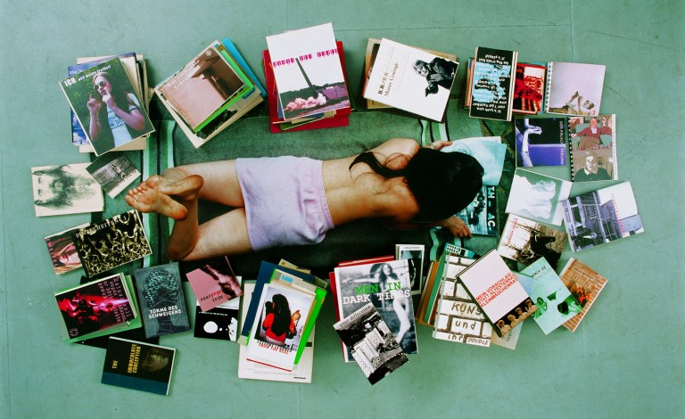 Rosemarie Trockel, Living Means Not Good Enough, 2002. Chromogenic color print, books, and a magazine, approximately 76 3:4 x 46 2:3 x 7 7:8 inches.