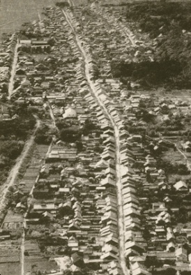 Archival aerial photograph of Japanese town.