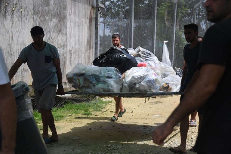 Asylum seekers in the Lombrum detention clean up camp after being abandoned by Australia.