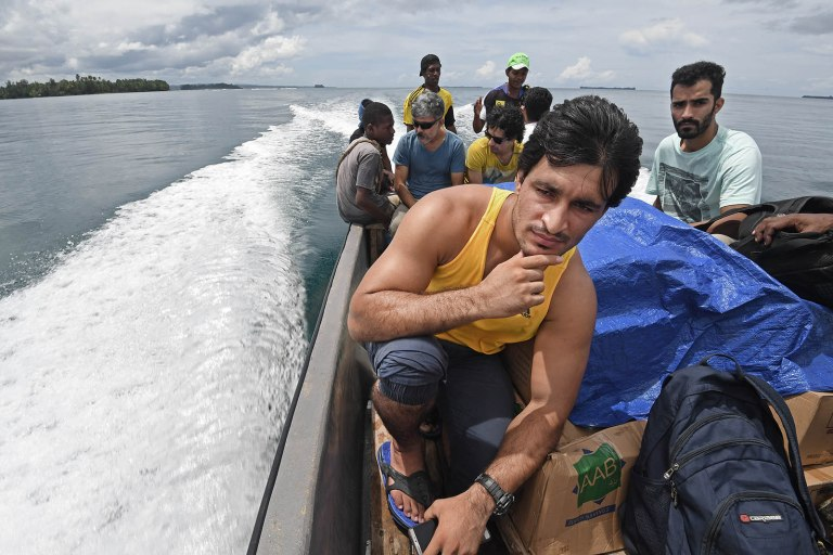 Pakistani refugee Ezatullah Kakar on the boat to the Lombrum detention centre with food and medicine