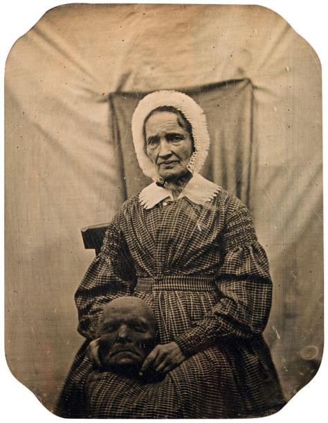 Woman holding a death mask, circa 1845 daguerreotype quarter plate, 74 x 57 mm.