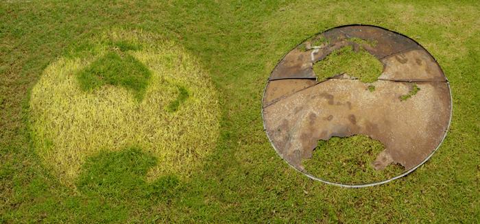 Lloyd Godman (2006) Planet III - tank lid template forming biotic imprint on grass Planet II Ephemeral sculpture, discarded corrugated iron water storage tank lid - grass - 2.4m x 6m approx