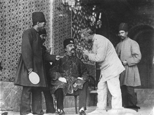 Al-Din Shah Qajar and photographer Sevryugin before photoshoot.