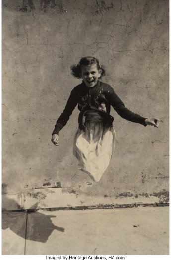 Edward Wallowitch (American, 1933-1981). Untitled (girl jumping on the sidewalk). Gelatin silver