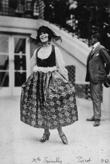 Séeberger Brothers (August 15, 1920) Actress Mlle. Spinelly (Élie Fournier) in a Poiret costume at the Grand-Prix de Deauville.
