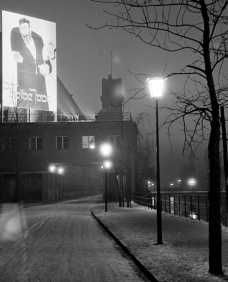 Art exhibition The Eternal Jew - View from the Uferstrasse to the library building of the German Museum, 1937. The huge poster of the propaganda exhibition The Eternal Jew was illuminated at night.