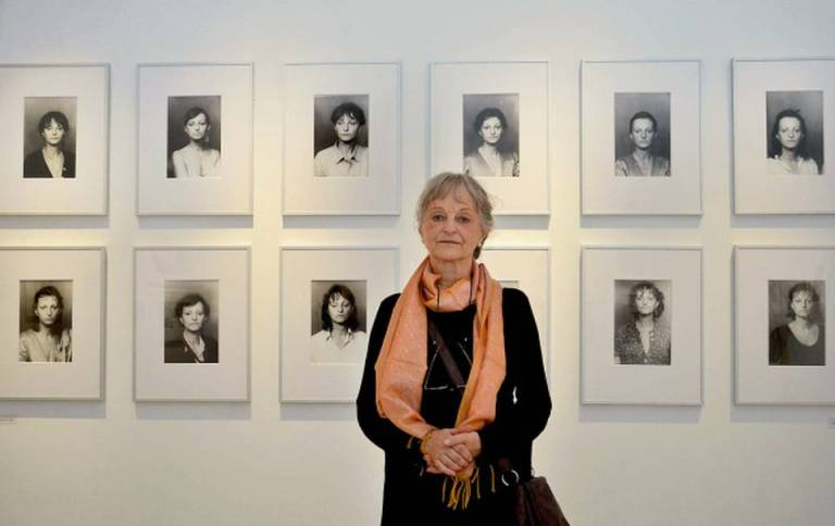 Germen photographer Helga Paris poses in front of her work displayed atDurbar Hall Art Gallery in