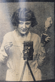 1930s folding camera with hand-held flash holder fired manually with shutter open.