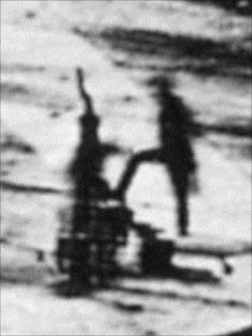 Detail from Daguerre's Boulevard du Temple; the man having his shoes polished and blurred figure of the shoeshine boy.