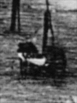 Detail from Daguerre's Boulevard du Temple; two women with a pram or barrow?