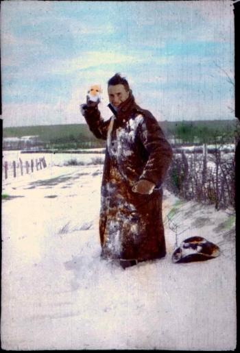 Les Chandler (c.1917) A bit of fun in the snow on the Western Front. Hand coloured silver gelatin print.