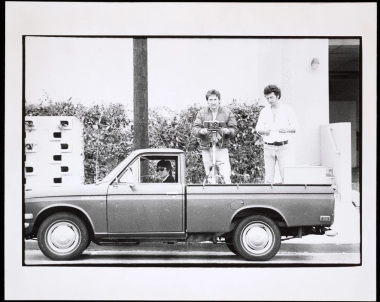 """Danny Kwan, left, Ed Ruscha and Bryan Heath in Ruscha's Datsun pickup truck in a 1975 image from the artist's """"Streets of Los Angeles"""" archive. (Ed Ruscha : Getty Research Institute)"""